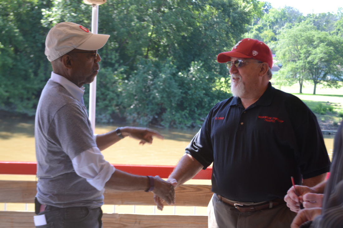 PEYTON NEELY   The Marietta Times  Michael Drake, president of The Ohio State University, left, talks with Gary Doan, Muskingum Township trustee, while on board the Valley Gem sternwheeler during the River Stabilization Tour Tuesday morning.