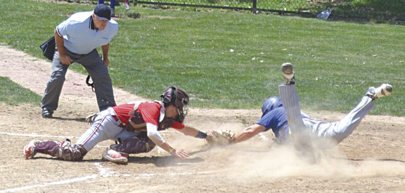 Beverly/Lowell's Derek Layton is safe at home plate as Parkersburg Post 15 catcher Josh Stephens tries to tag him during American Legion Game 1 action at Fort Frye Sunday afternoon. Photo by Ron Johnston.