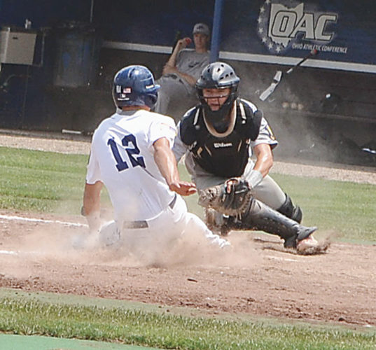 Marietta Post 64's Isaac Huffman slides safely into home plate as Lancaster catcher Logan Fyffe attempts to apply the tag during an American Legion baseball game against Lancaster Saturday at Don Schaly Stadium. Photo by Mike Morrison.