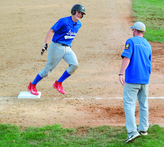 RON JOHNSTON The Marietta Times Beverly/Lowell Post 389/750's Logan Isner, left, rounds third base as coach Tyler Engle congratulates him after a home run during an American Legion baseball game against Hebron Tuesday.