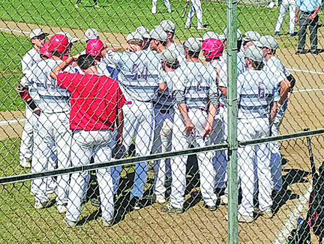 Courtesy photo Members of The Shield 19U baseball team huddle during a game earlier this summer.