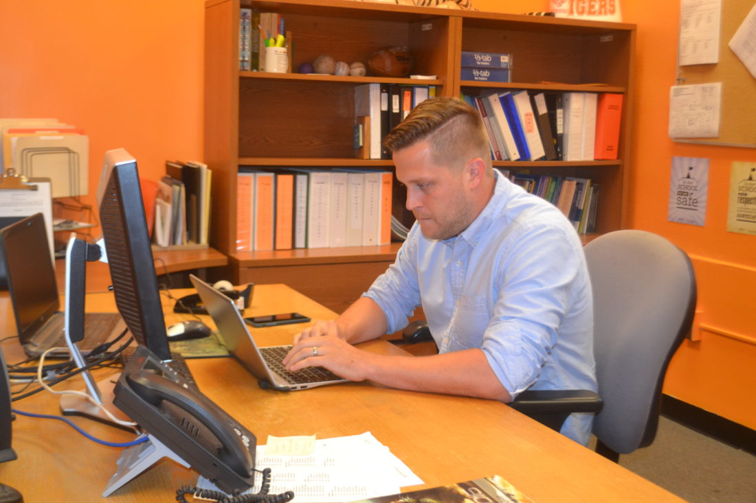 PEYTON NEELY   The Marietta Times Tim Fleming, new assistant principal at Marietta Middle School, works on some school preparations in his office on Thursday.