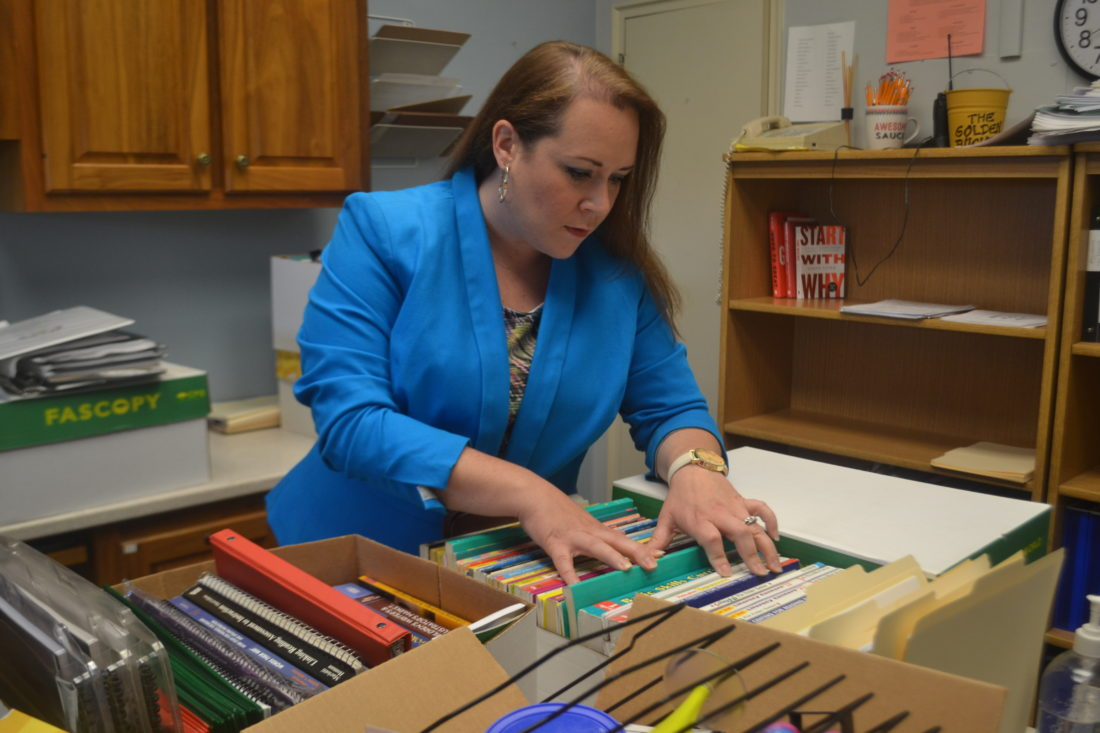 PEYTON NEELY   The Marietta Times Kristi Lantz, new principal at Phillips Elementary School, files books while organizing her new office before the start of school on Thursday.