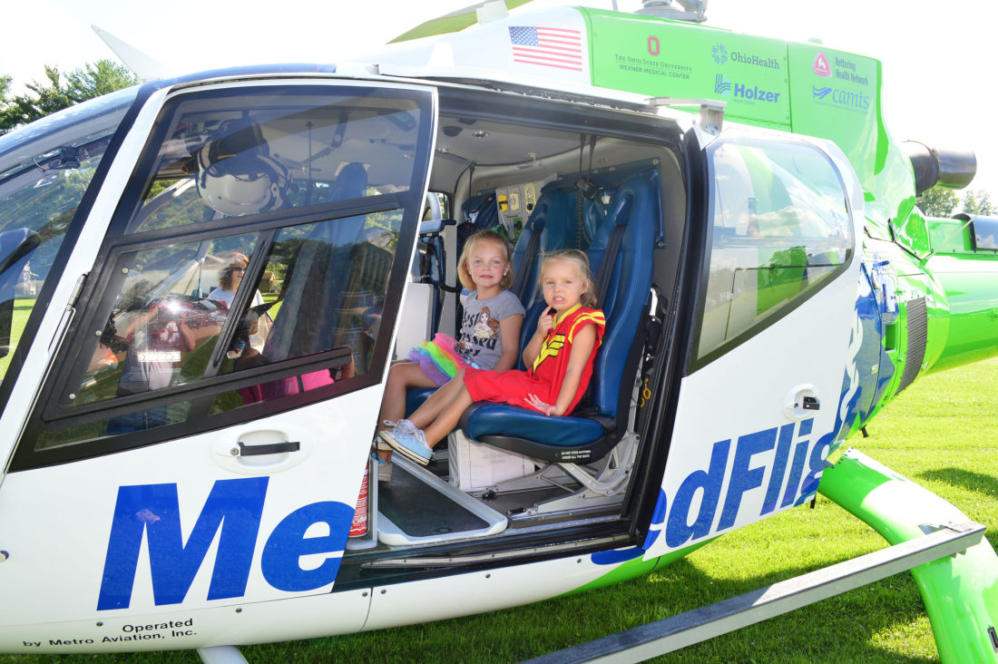 DOUG LOYER  Special to the Times Madeline Morganstern, 6, and her sister Sophia Morganstern, 3, both of Hackney, enjoy sitting in the Med Flight helicopter.
