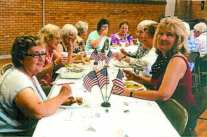 Muskingum Garden Club members during an Ikebana event at the Betsey Mills Club. In front, Nadine Kasick and Judy VanDyk.