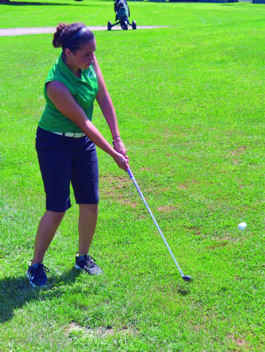 RON JOHNSTON The Marietta Times Waterford High's Alicia Dickinson hits an iron shot during the Waterford Invitational Wednesday at Lakeside Golf Course in Beverly. The Lady Wildcats won the girls team championship.