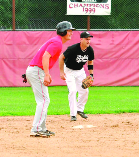 Chris Cunningham (right), the Mid-Ohio Valley Adult Baseball League president, gets into fielding position during a game earlier this season in Parkersburg.  Photo courtesy of Robin Pannell