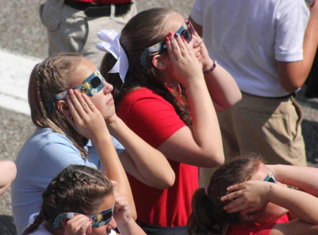JANELLE PATTERSON   The Marietta Times Students of St. Mary School in Marietta make sure to keep their eyes protected while watching a solar eclipse in Marietta Monday.