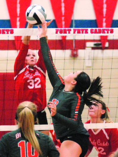 JORDAN HOLLAND The Marietta Times Fort Frye's Karlee Ross (32) goes for a block against Belpre's Ryleigh Hannah (12) during a high school volleyball match Monday in Beverly.