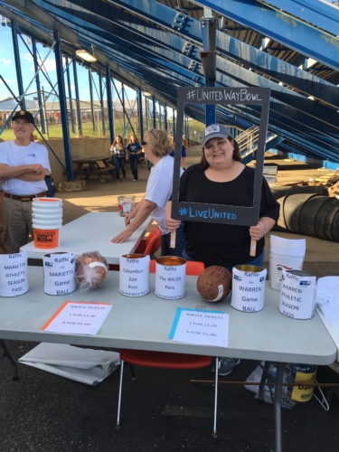 Photo submitted by Amanda Cech                Volunteers with the United Way of Washington County set up a raffle table at a past United Way Bowl football game. This year's game will be held at Don Drumm Stadium on Friday.
