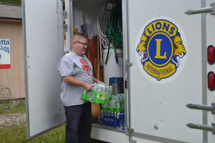 ERIN O'NEILL  The Marietta Times Randy Wilson, with the Marietta Noon Lions Club, prepares the food trailers for moving into place at the Ohio River Sternwheel Festival on Thursday. Vendors converged on downtown Marietta to line up and will be open for business this evening through Sunday of the festival.