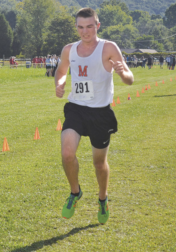 Marietta High's Collin Doughty crosses the finish line at Saturday's Chick-fil-A Invitatonal in Mineral Wells, W.Va. Photo by Ron Johnston.