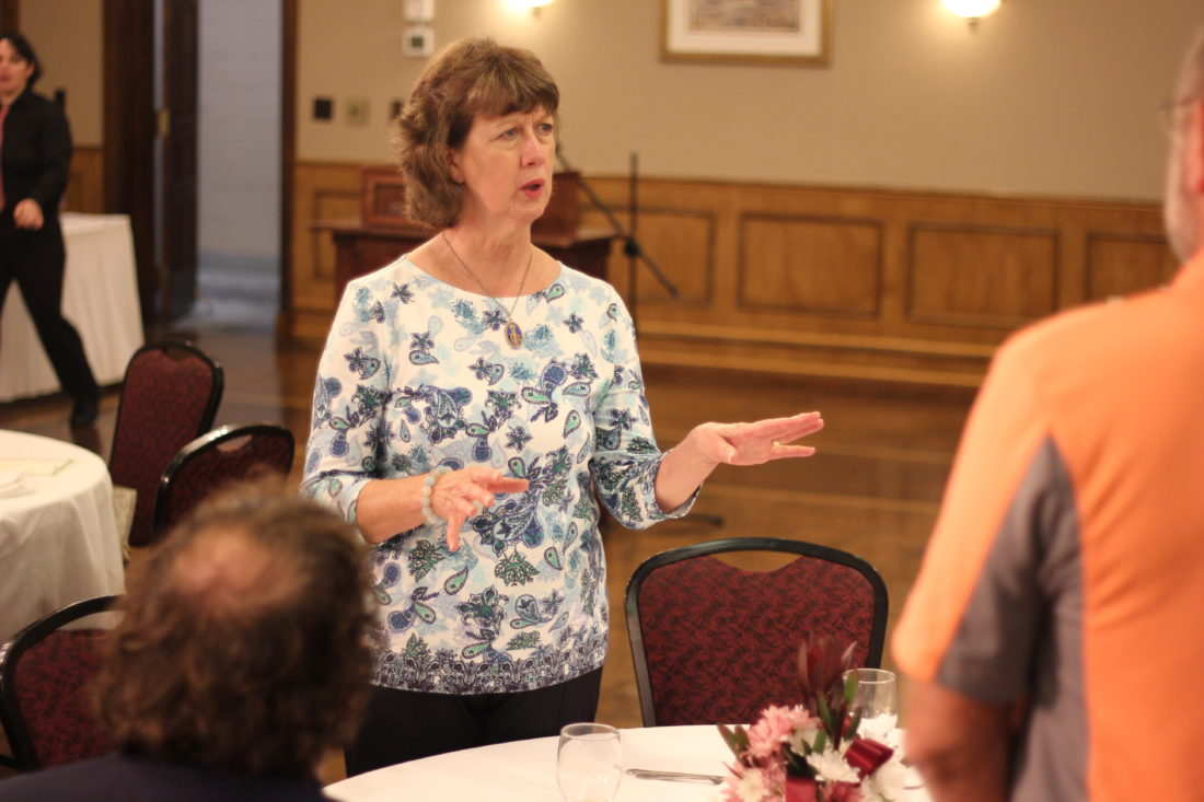 JANELLE PATTERSON   The Marietta Times Linda Schaad, chair of the Knights of Columbus community meals in Marietta, discusses food insecurity with employees of Antero Resources at a luncheon Wednesday at the Lafayette Hotel.