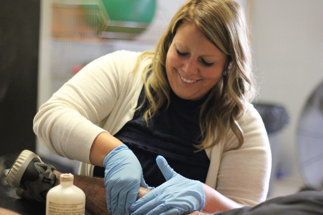 JANELLE PATTERSON   The Marietta Times Madonna Buegel, 23, of New Matamoras, is the athletic trainer assigned by Memorial Health System to provide services to the Marietta City School District.