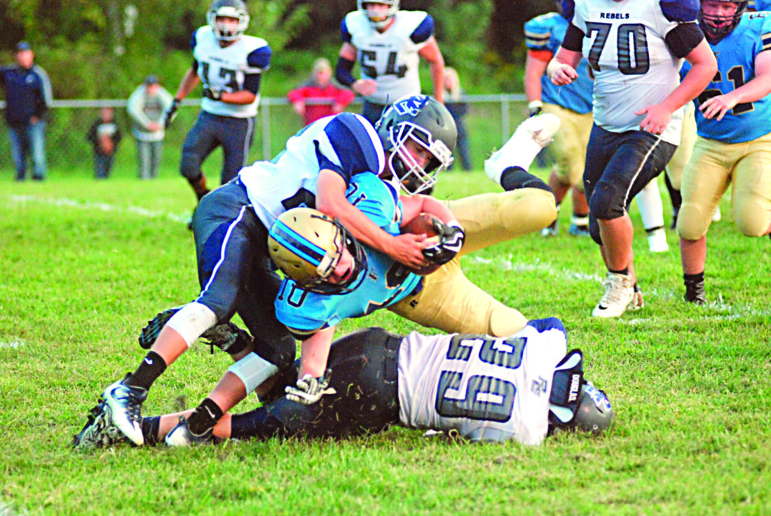 MIKE MORRISON The Marietta Times Frontier's Lane Snyder (10) is brought down by a pair of Ritchie County defenders during a high school football game last Friday in New Matamoras.