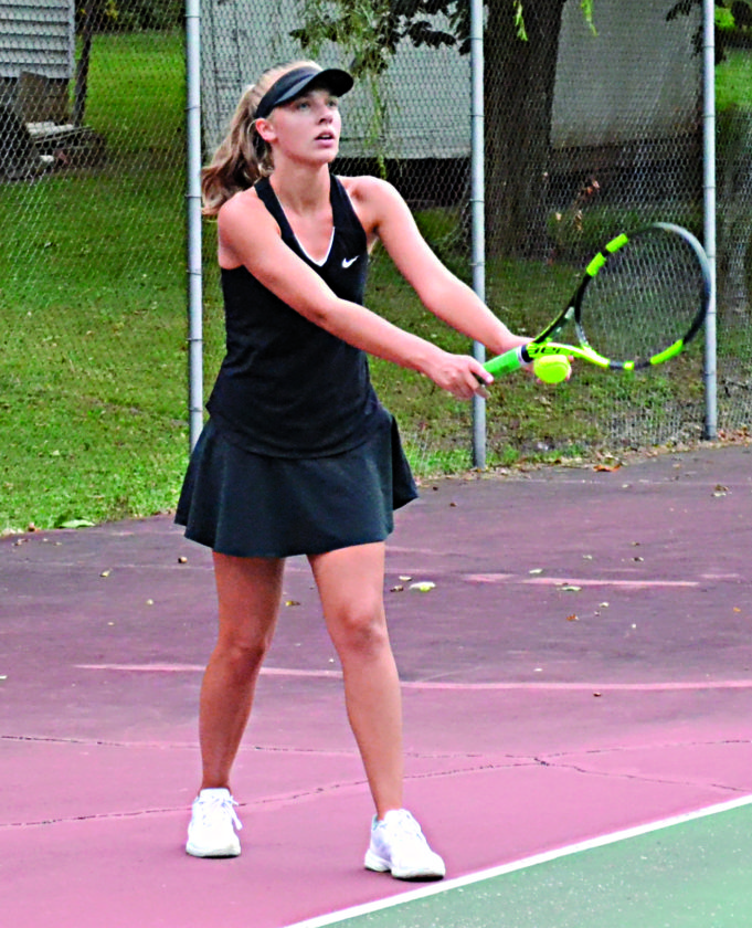 RON JOHNSTON The Marietta Times Marietta High's Meredith Coil prepares to serve during a high school tennis match against Athens Wednesday at Glendale Courts.