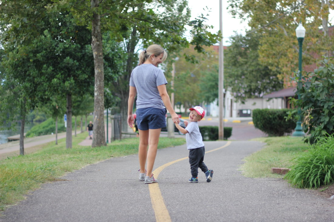 JANELLE PATTERSON   The Marietta Times Brandy Circle, 41, of Dublin and her 21-month-old son Chase, walk the River Trail in Marietta Wednesday afternoon while on a visit to Circle's mother.