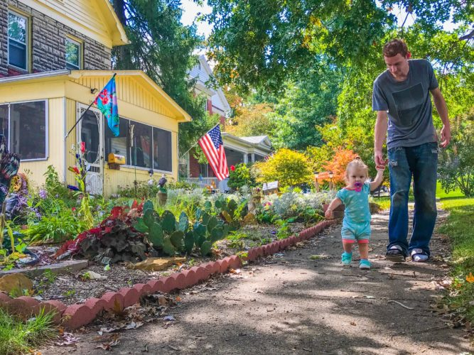 JANELLE PATTERSON   The Marietta Times Justin Brooks, 27, and his daughter Arianah, 18-months, walk through in their Norwood neighborhood Friday.