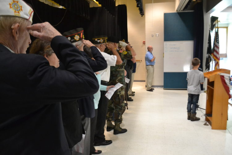 MICHAEL KELLY   The Marietta Times Guests and speakers join students and staff at Matamoras Elementary School on Fridayi in the Pledge of Allegiance to open the school's annual program for National POW/MIA Day.