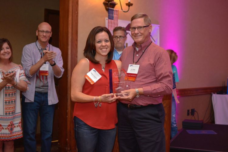 Photo submitted Sharon Anderson receives the first Robert Baronner Outstanding Community Banker Award.