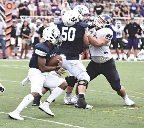 Marietta College's Darrien Fields (4) looks for running room during a college football game Saturday against Mount Union. Photo courtesy of Nate Knobel.