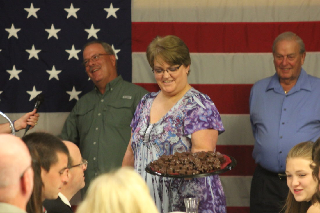 JANELLE PATTERSON   The Marietta Times Belpre City Council Fourth Ward Candidate Penne Riffle elicits bids in the dessert auction at the Washington County Republican Party Reagan Dinner at the Marietta Shrine Club Tuesday.