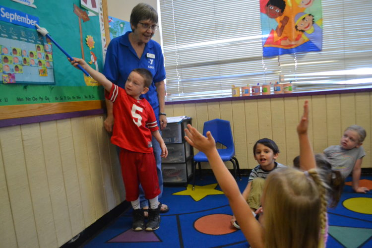 MICHAEL KELLY   The Marietta Times Debbie Hockenberry leads a preschool class at the Marietta  Family YMCA on Tuesday. In addition to drop-in care, the program enrolls about 75 children in its after-school sessions.