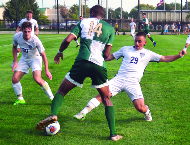 RON JOHNSTON The Marietta Times Marietta College's Noah Laliberty (20) and Alex Gruss (29) defend as Bethany College's Baboucar Sallah-Mohammed (14) tries to make a move with the ball during a college men's soccer match Wednesday. MC won 1-0 in double overtime.