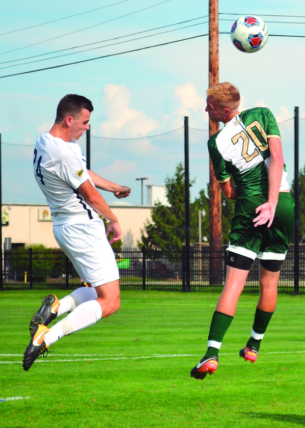 RON JOHNSTON The Marietta Times Marietta College's Sebastian Ziaja, left, and Bethany's Zac Hayhurst battle for a header during a college men's soccer match Wednesday.