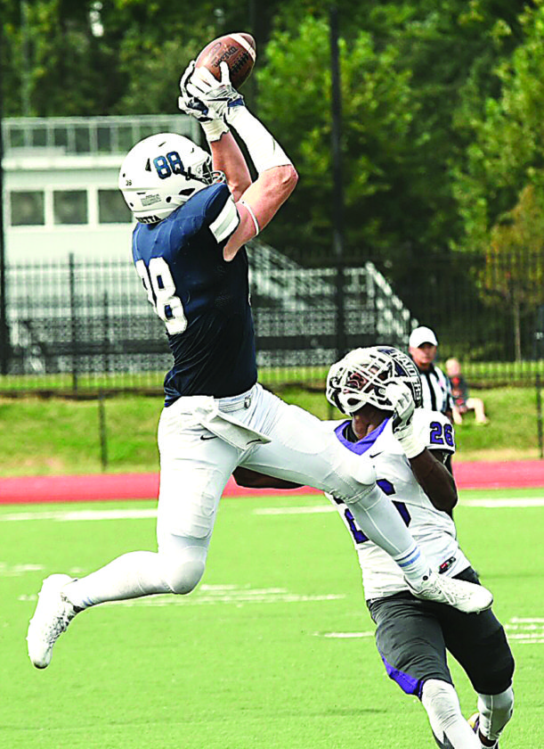 Photo by Nate Knobel Marietta College's Andrew Barker goes up to catch a pass during a college football game against Mount Union last Saturday at Don Drumm Stadium.