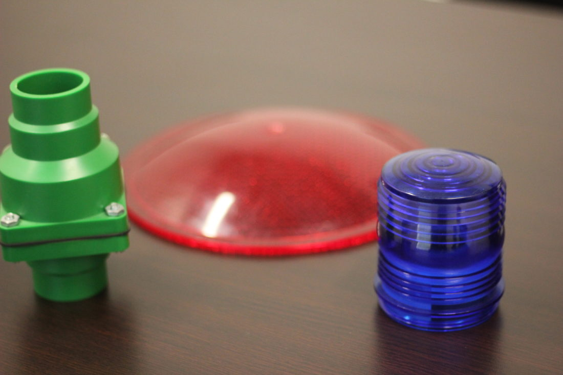 JANELLE PATTERSON   The Marietta Times  Plastic items like a sump pump, light cap and stop light fronts are made from plastics sold by ARC Resin Corporation which just moved into the new Keystone Warehousing in Marietta.
