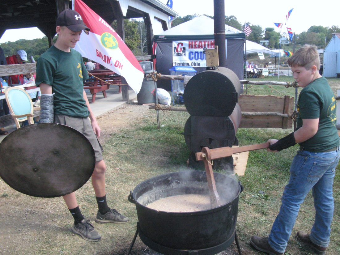 JEFFREY SAULTON  Special to the Times Stirring soup beans at the 145th annual Barlow Fair on Saturday were Brooks Suprano, left, and Issac Campbell, right, both members of Troop 217 based in Barlow.