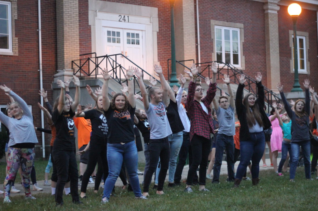 """JANELLE PATTERSON   The Marietta Times Marietta High School and Marietta Middle School choir students perform a choreographed flash mob to Smash Mouth's version of  """"I'm a Believer"""" during Marietta Main Street's First Fridays festivities."""