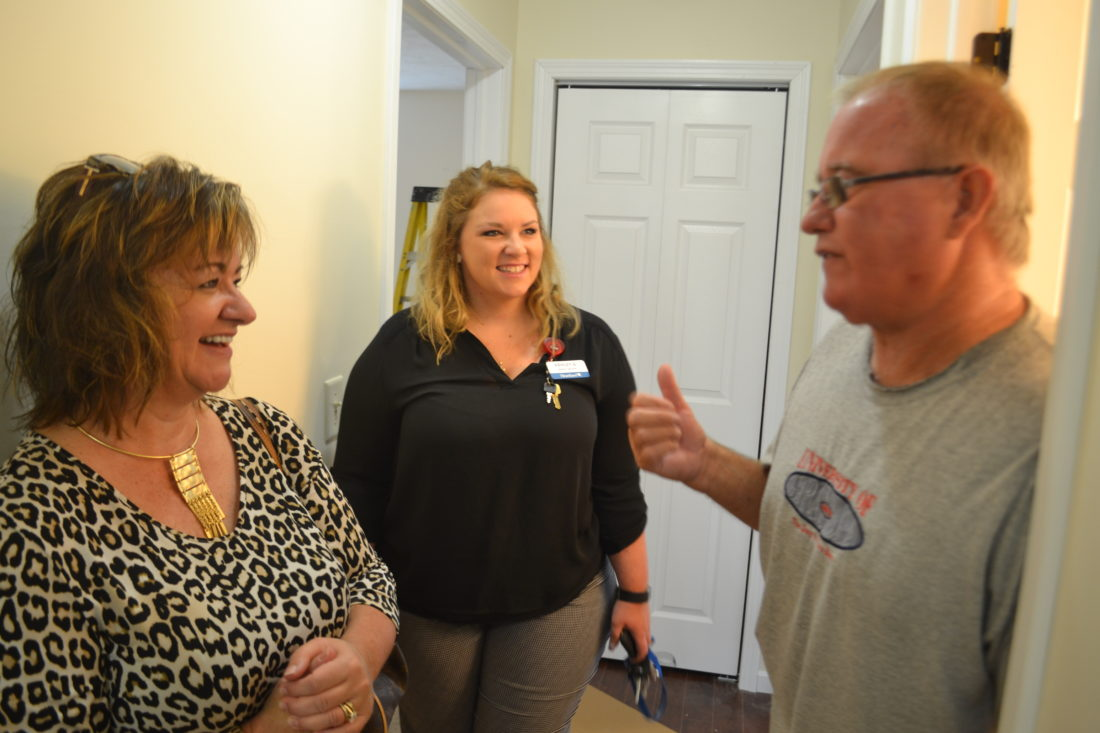 MICHAEL KELLY   The Marietta Times Ashley Sams, center, talks with Lisa Collins of Habitat for Humanity of the Mid-Ohio Valley and Ed Bonar, Habitat's construction manager, in the hallway of her nearly-complete new house in Williamstown. Her home is expected to be done in about two weeks; it will be the 100th home built by the organization.