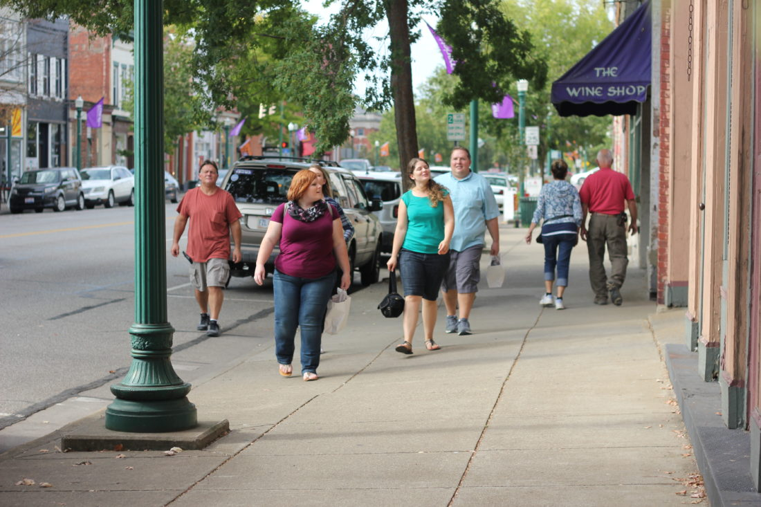 JANELLE PATTERSON   The Marietta Times Shoppers flock to the sidewalks of Marietta's downtown business district Friday.
