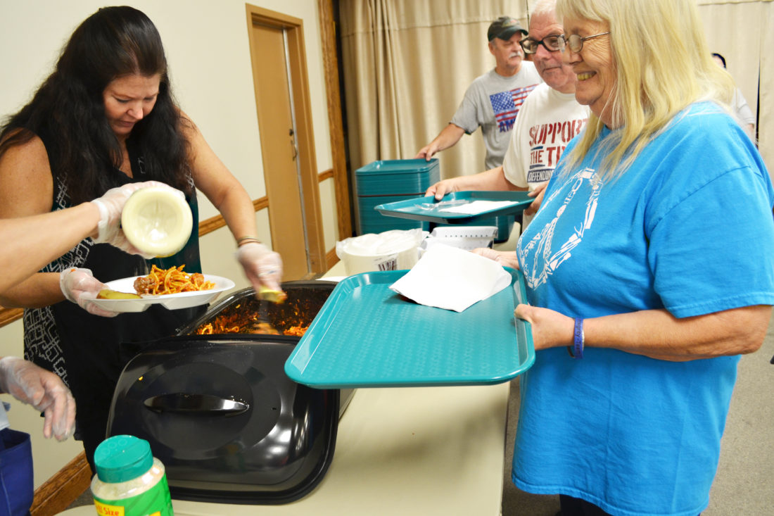 ERIN O'NEILL  The Marietta Times Teresa Coleman, a volunteer at the Daily Bread Kitchen, serves spaghetti and meatballs to Linda Spriggs. Spriggs and her ex-husband enjoy meeting with each other and friends every week and say that the community meal is a blessing.