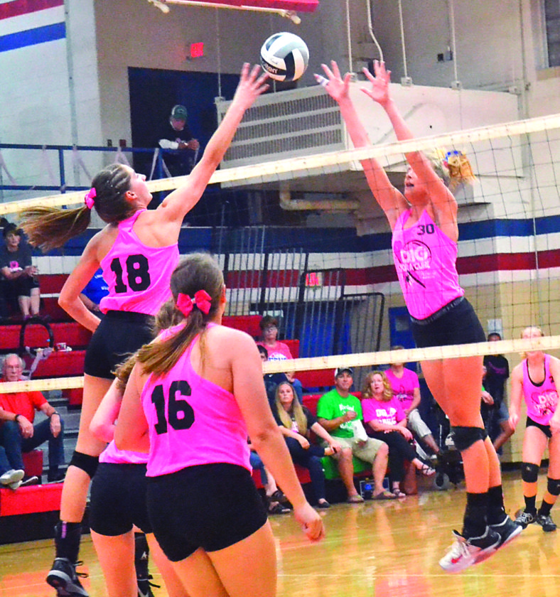 RON JOHNSTON The Marietta Times Waterford's Megan Ball (18) tips the ball as Fort Frye's Alissa Ginther (30) tries to block it during a high school volleyball match Tuesday in Beverly. Waterford won in five sets.