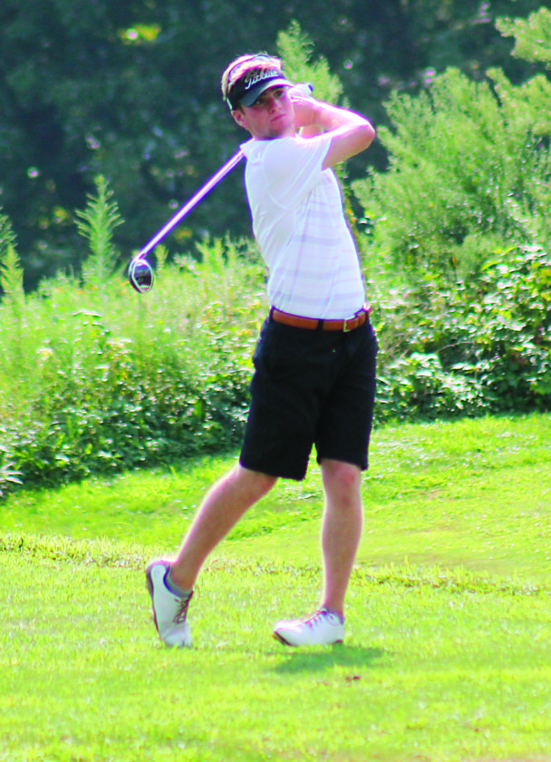 Photo by Dawk Hollister Marietta High senior Gage Herb watches his shot during the Division I East/Southeast District golf tournament Tuesday at EagleSticks Golf Course in Zanesville. Herb shot a 73 to advance to state.