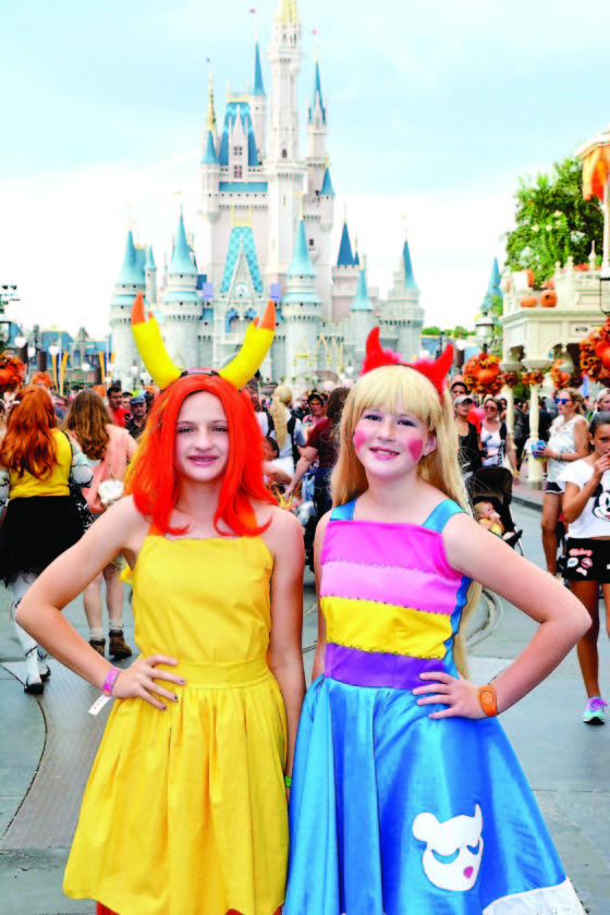Photo submitted by LeeAndra Smith Kenzie and Lyanna Smith dress in costume during a recent visit to Walt Disney World. The Smith family from Marietta enjoys coming up with creative ways to celebrate Halloween.