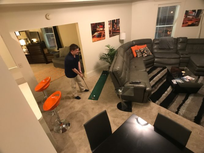 JANELLE PATTERSON   The Marietta Times Tanner Seago, 28,  pauses before taking a shot on his putting green in his loft apartment in Marietta Wednesday.