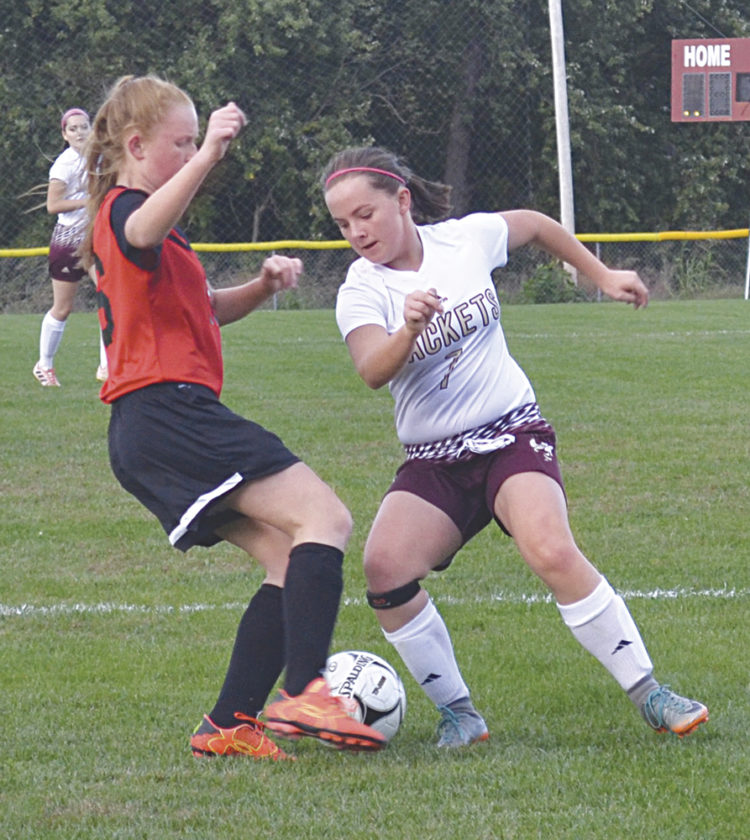 Williamstown High's Katie Pickering, right, battles Ravenswood High's Savannah Bibbee, left, for the ball during sectional girls' soccer action in Williamstown Monday. The Yellowjackets won 9-0. Photo by Ron Johnston.