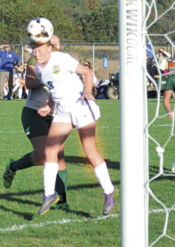 Warren freshman Taylor Sloan heads teammate Taylor Vickers' (not pictured) corner kick into the goal to give the Warriors a 1-0 lead during first-half girls' sectional soccer action at WHS Tuesday. The 5-foot-2 Sloan also had a head goal in the second half, and helped Warren defeat Athens, 3-0. Ron Johnston, THE MARIETTA TIMES