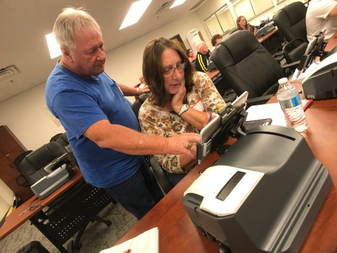 JANELLE PATTERSON   The Marietta Times Jedd Butler helps Patricia Henke learn to use the ExpressPoll books to be used in the Nov. 7 election to check-in voters during poll worker training Wednesday at the Washington County Board of Elections.
