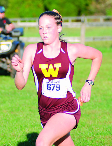 JAY W. BENNETT The Marietta Times Williamstown's Ella Hesson approaches the finish line during Thursday's W.Va. Class AA/A regional cross country championship in Mineral Wells, W.Va.