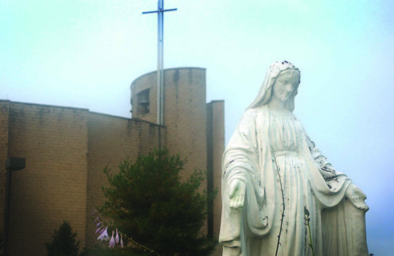Art Smith   The Marietta Times A statue of the Virgin Mary along the entrance road to St. Ambrose Catholic Church at 5080 School House Road in Little Hocking. The church holds weekend masses at 5 p.m on Saturday and 8 and 11 a.m. on Sunday. Weekday masses are held at 9 a.m on Monday, Wednesday and Friday, and at 6 p.m. on Tuesday and Wednesday. The Times will feature photos of area churches on this page most Saturdays. If you have a photo that showcases the beauty of an area house of worship, submit it to Art Smith asmith@mariettatimes.com for possible inclusion on this page.