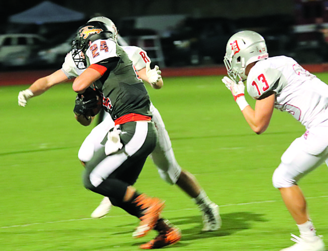 Photo courtesy of Lisa Fisher Marietta's Dominic Vanfossen (24) carries the ball during a high school football game against Dover Friday night at Don Drumm Stadium. Dover won, 49-6.