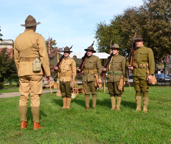 DOUG LOYER  Special to the Times Cyrus Moore of the Southern Ohio History Center leads these WW1 reenactors through drills.