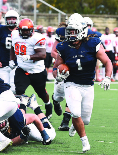 Photo courtesy of Nate Knobel Marietta College's Roger Walker (1) carries the ball during a college football game against No. 24 Heidelberg Saturday at Don Drumm Stadium. Marietta won, 44-21.