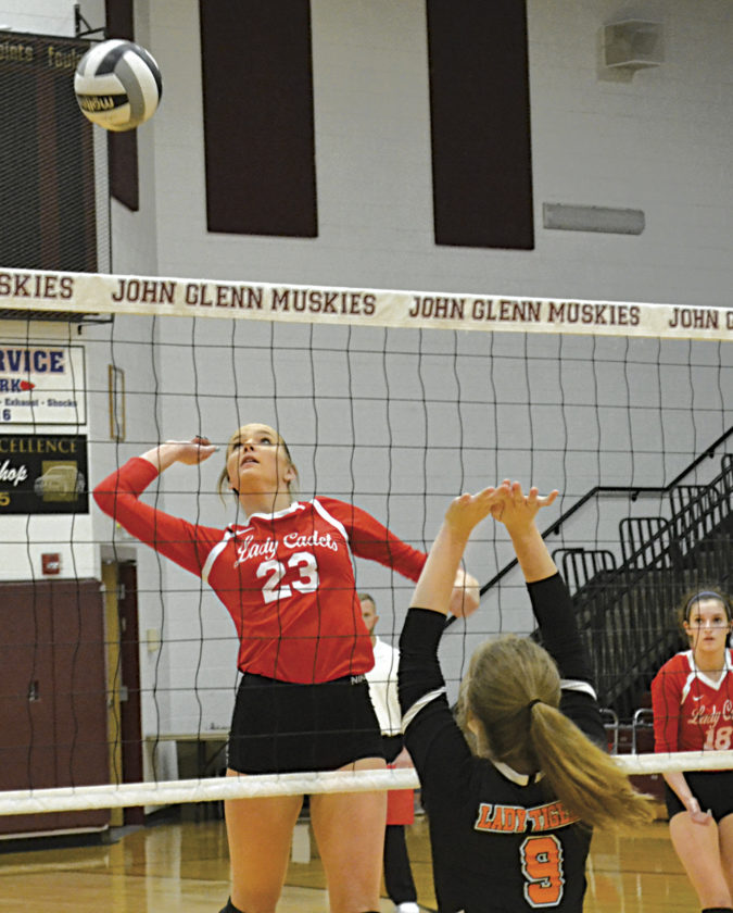 Fort Frye's Alissa Ginther (23) goes for a kill as Shadyside's Mack Osman (9) defends during Division IV district semifinal volleyball action at John Glenn High Monday night. Fort Frye won 3-1. Photo by Ron Johnston.