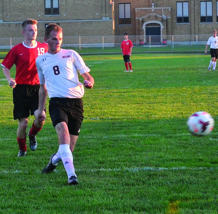Belpre's Kellar Windland shoots during a high school soccer match against Caldwell earlier this season. Windland also is a cross country and track standout for the Golden Eagles.  RON  JOHNSTON The Marietta Times